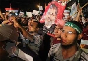 تصویر درگیری میان نیروهای امنیتی مصر وهواداران مرسی در میدان التحریر