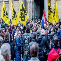 تصویر توهین به ساحت مقدس پیامبر(ص) در تظاهرات ضداسلامی بلژیک