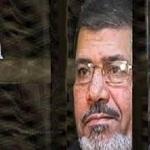 تصویر مرسی : سیسی مسوول کشتارهای انقلاب ژانویه است